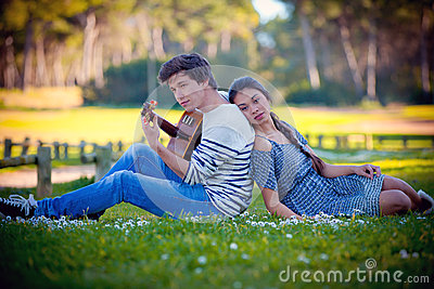 Romantic couple playing guitar