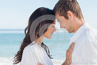 Romantic couple relaxing and embracing on the beach