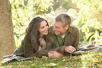 Romantic Couple Relaxing Outdoors In Autumn