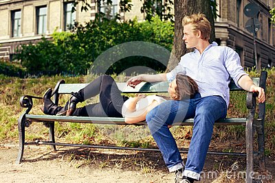 Romantic Couple Resting on the Park Bench