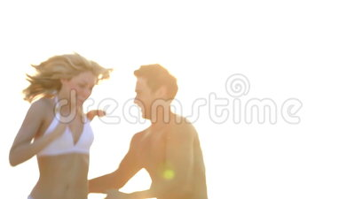 Romantic Couple Running On Beautiful Tropical Beach. Couple running along beach before man picks up woman and spins her around.Shot on Canon 5d Mk2 with a frame
