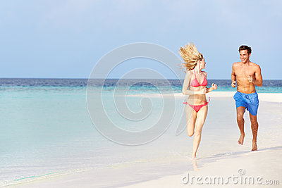 Romantic Couple Running On Beautiful Tropical Beach