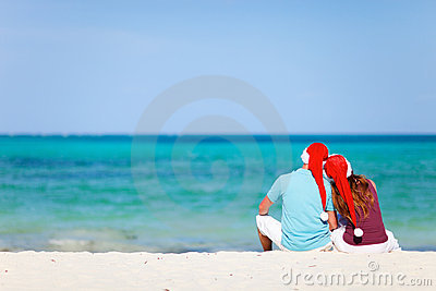 Romantic couple in Santa hats