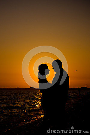 Romantic couple silhouette on the beach
