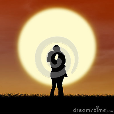 Romantic couple silhouette kiss by sunset