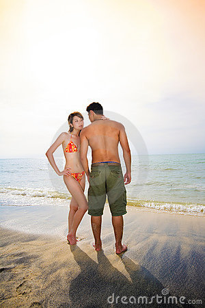 Romantic couple on sunset beach