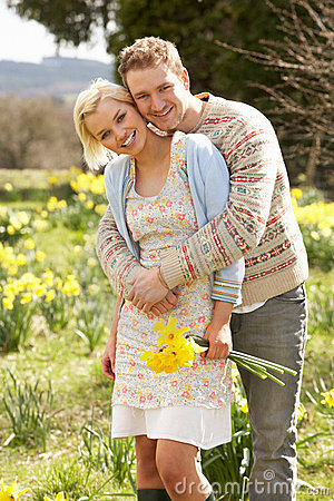 Romantic Couple Walking Amongst Spring Daffodils