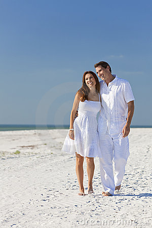 Romantic Couple Walking on An Empty Beach