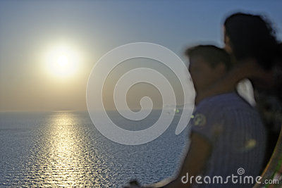 Romantic couple watching sunset