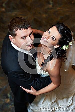 Romantic embrace bride and groom in wedding dance