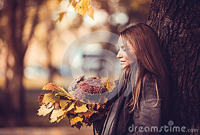 Romantic girl with autumn bouquet