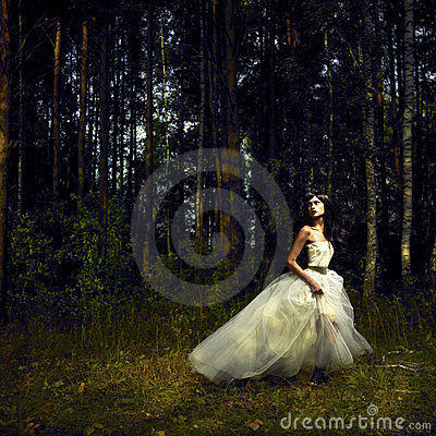 Romantic girl in fairy forest