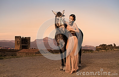 Romantic girl with horse
