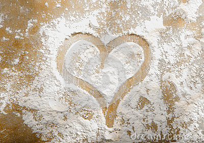 Romantic heart in sprinkled flour