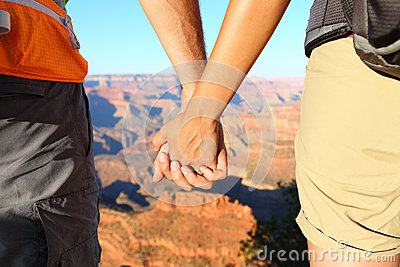 Romantic hiking couple holding hands, Grand Canyon