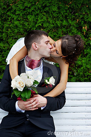 Romantic kiss beloved bride and groom