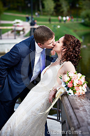 Romantic kiss bride and groom