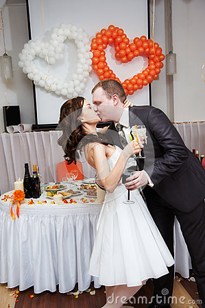 Romantic kiss bride and groom in wedding banquet