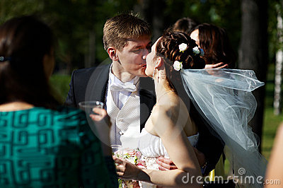 Romantic kiss bride and groom at wedding walk