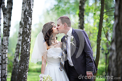 Romantic kiss groom and happy bride