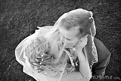 Romantic kiss happy bride and groom