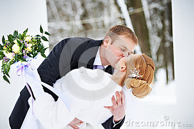 Romantic kiss happy bride and groom