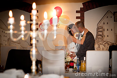 Romantic kiss of married couple