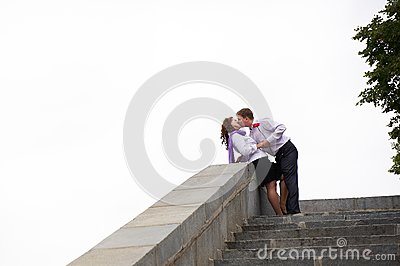 Romantic kiss on the stone stairs