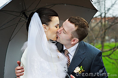 Romantic kiss at wedding walk
