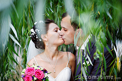 Romantic kiss on wedding walk