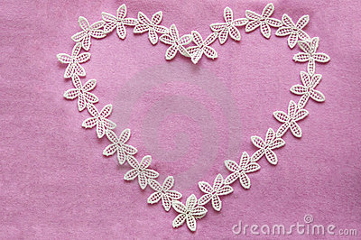 Romantic lacy heart on pink background