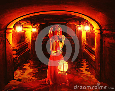 Romantic lady in red holding a lantern in a dark dungeon