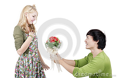 Romantic man giving flowers