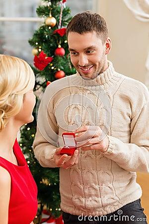 Romantic man proposing to a woman
