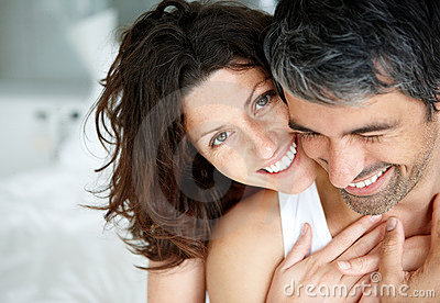 Romantic mature couple enjoying themselves on bed