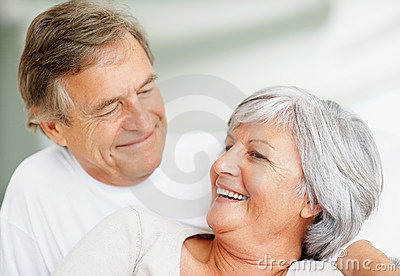 Romantic old couple smiling at each other