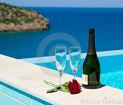 Romantic picnic near pool in mediterranean resort