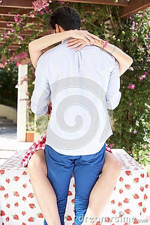 Romantic Portrait Of Couple Embracing Outdoors