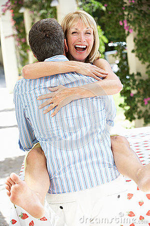 Romantic Portrait Of Senior Couple Embracing