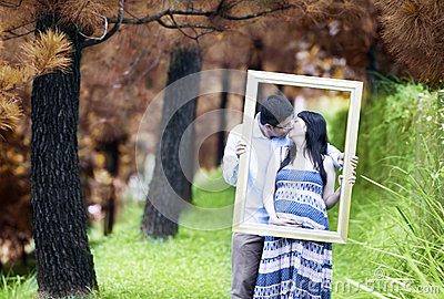 Romantic pregnant couple on autumn day