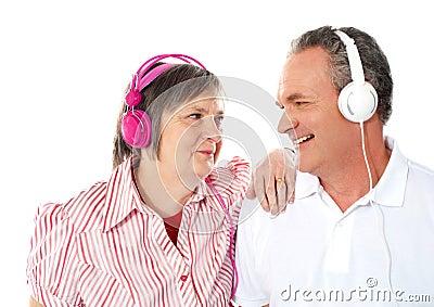 Romantic senior couple enjoying music together