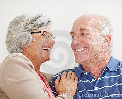Romantic senior couple looking at each other