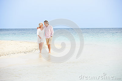 Romantic Senior Couple Walking On Beautiful Tropical Beach