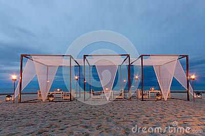 Romantic set up dinner on the beach, twilight time