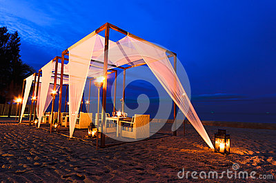 Romantic set up dinner on the beach, twilight time