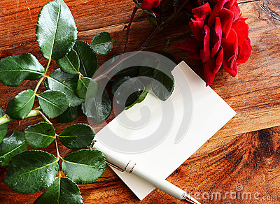 Romantic shot with blank page and roses
