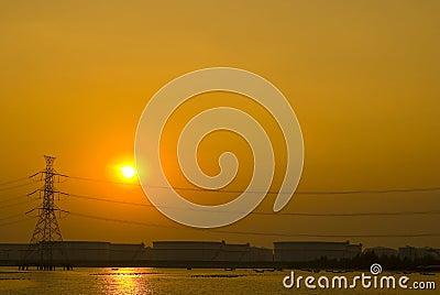 Romantic sunset over petrochemical plant