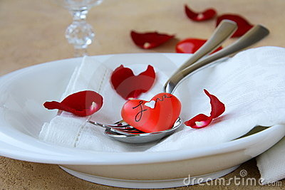 Romantic table setting with rose petals