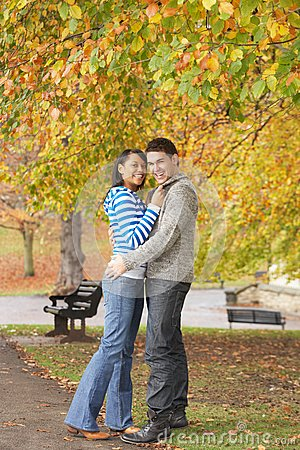 Romantic Teenage Couple In Autumn Park Royalty Free Stock Photos - Image: 13671738