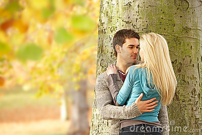 Romantic Teenage Couple By Tree